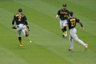 Pittsburgh Pirates third baseman Erik Gonzalez (2) is unable to catch a pop up by St. Louis Cardinals' Tommy Edman as Pirates left fielder Ka'ai Tom (60) and shortstop Kevin Newman (27) watch during the second inning of a baseball game Tuesday, May 18, 2021, in St. Louis. Two runs scored on the play. (AP Photo/Jeff Roberson)