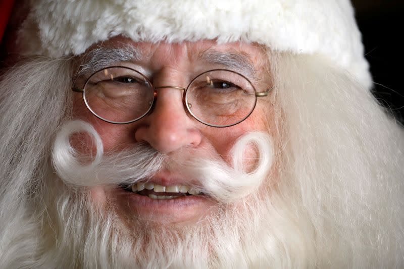 Fred Honerkamp, smiles while wearing his Santa Claus outfit as he prepares to visit Jerusalem's Old City together with a group of Santa Clauses from around the world, at a hotel in Jerusalem