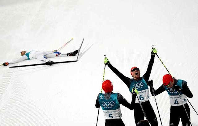 Nordic Combined Events - Pyeongchang 2018 Winter Olympics - Men's Individual 10 km Final - Alpensia Cross-Country Skiing Centre - Pyeongchang, South Korea - February 20, 2018 - Gold medalist, Johannes Rydzek of Germany, silver medalist, Fabian Riessle of Germany and bronze medalist Eric Frenzel of Germany celebrate as Jarl Magnus Riiber of Norway reacts. REUTERS/Carlos Barria TPX IMAGES OF THE DAY