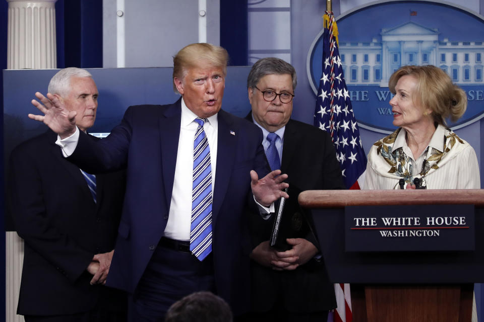 President Donald Trump gestures as he asks a question to Dr. Deborah Birx, White House coronavirus response coordinator, during a briefing about the coronavirus in the James Brady Briefing Room on March 23, 2020, in Washington. (Alex Brandon/AP)