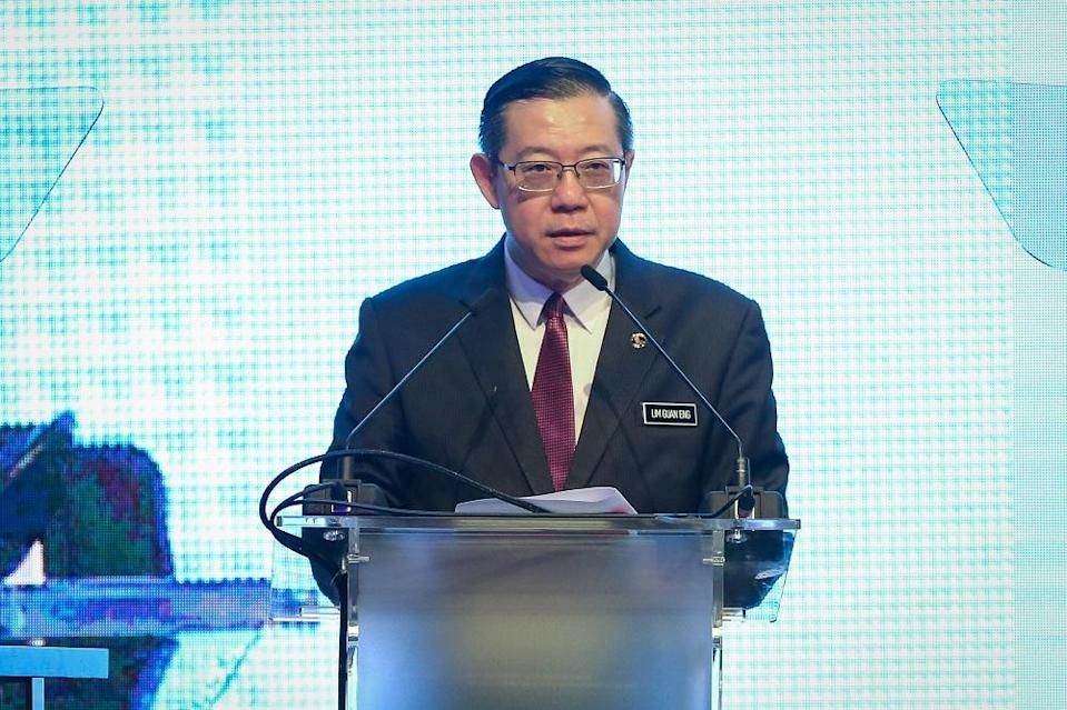 Finance Minister Lim Guan Eng says Malaysia's direct debt increased RM94.1 billion by the middle of the year. — Picture by Yusof Mat Isa