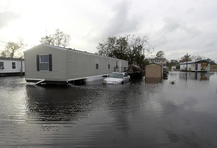 Floodwaters from Isaac surround a home Friday, Aug. 31, 2012, in Ironton, La. Isaac is now a tropical depression, with the center on track to cross Arkansas on Friday and southern Missouri on Friday night, spreading rain through the regions. (AP Photo/John Bazemore)