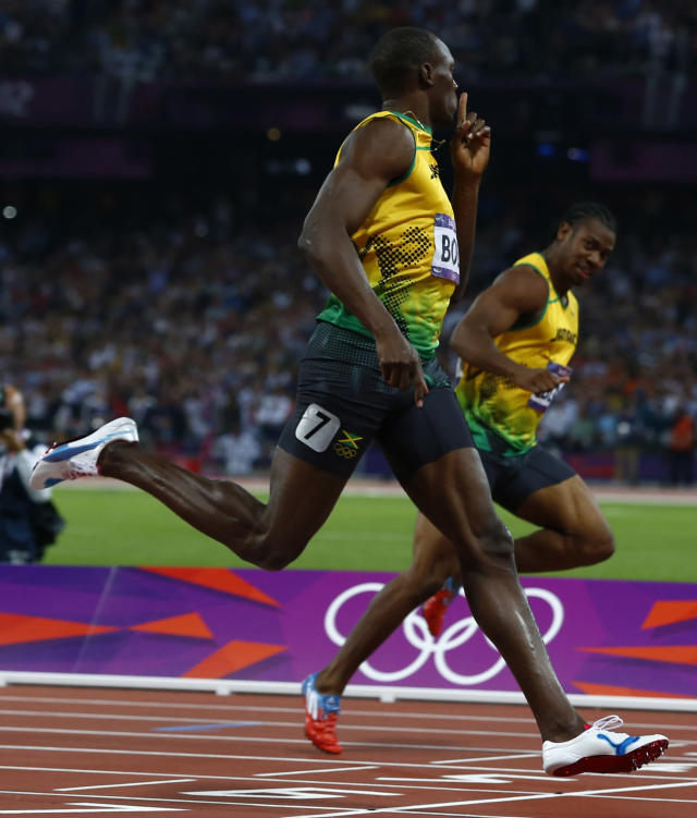Jamaica's Usain Bolt celebrates as he crosses the finish line to win the men's 200m final ahead of compatriot Yohan Blake (R) during the London 2012 Olympic Games at the Olympic Stadium August 9, 2012. REUTERS/Eddie Keogh (BRITAIN - Tags: OLYMPICS SPORT ATHLETICS)
