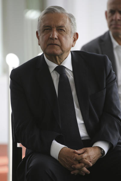 Mexico's President Andres Manuel Lopez Obrador waits to deliver a speech during his visit to a public hospital in Cuernavaca, Mexico, Friday, June 19, 2020. Lopez Obrador is desperate to restart Mexico's struggling economy after being cooped up under social distancing measures due to the new coronavirus pandemic. (AP Photo/Fernando Llano)
