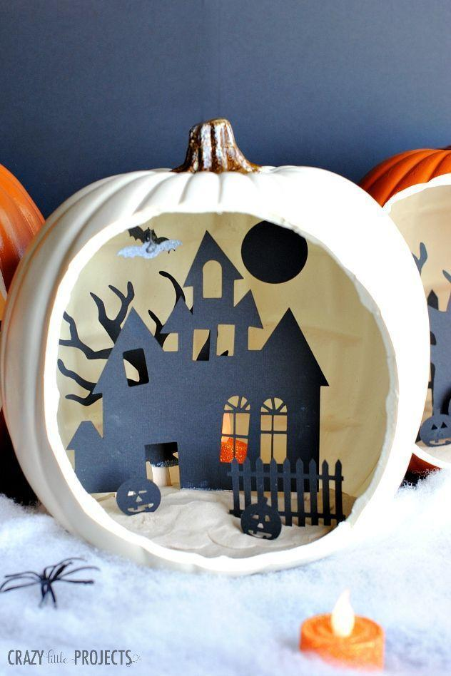 """<p>Your mantel will be the talk of the annual Halloween party with this creative pumpkin sitting on top of it. The scene within is crafted out of card stock, making it a budget-friendly project. </p><p><strong>Get the tutorial at <a href=""""https://eighteen25.com/shadow-box-pumpkins/"""" rel=""""nofollow noopener"""" target=""""_blank"""" data-ylk=""""slk:Eighteen 25"""" class=""""link rapid-noclick-resp"""">Eighteen 25</a>.</strong></p><p><a class=""""link rapid-noclick-resp"""" href=""""https://go.redirectingat.com?id=74968X1596630&url=https%3A%2F%2Fwww.walmart.com%2Fsearch%2F%3Fquery%3Dcard%2Bstock&sref=https%3A%2F%2Fwww.thepioneerwoman.com%2Fhome-lifestyle%2Fcrafts-diy%2Fg36982763%2Fpumpkin-carving-ideas%2F"""" rel=""""nofollow noopener"""" target=""""_blank"""" data-ylk=""""slk:SHOP CARD STOCK"""">SHOP CARD STOCK</a></p>"""