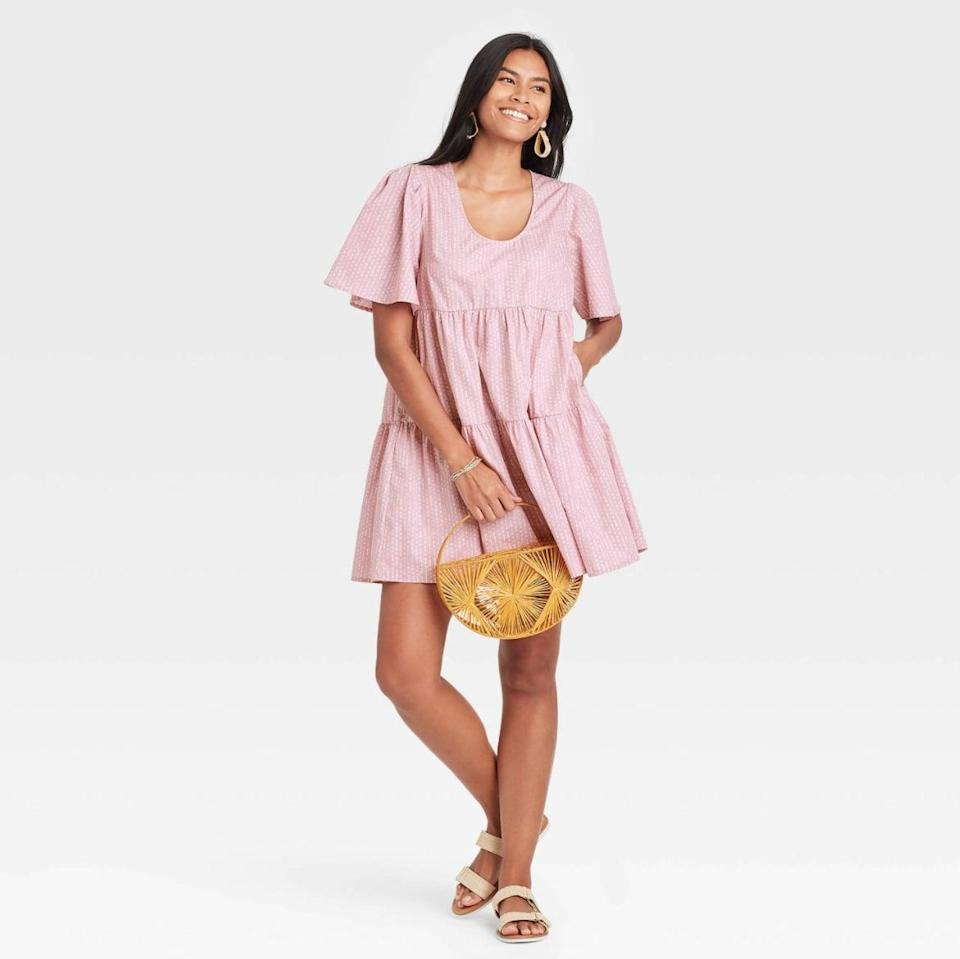 <p>If you're looking for something with a little bit of pattern, try the <span>A New Day Flutter Short Sleeve Tiered Dress in Purple</span> ($25). You can style it with everything from wedges to sandals.</p>