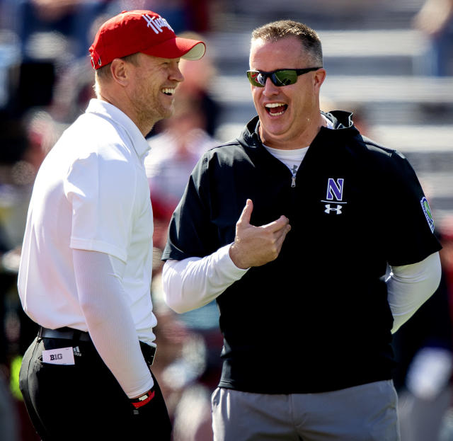 Nebraska head coach Scott Frost, left, enjoys a moment with Northwestern head coach Pat Fitzgerald prior to an NCAA college football game, Saturday, Oct. 5, 2019 in Lincoln, Neb. (Francis Gardler/Lincoln Journal Star via AP)
