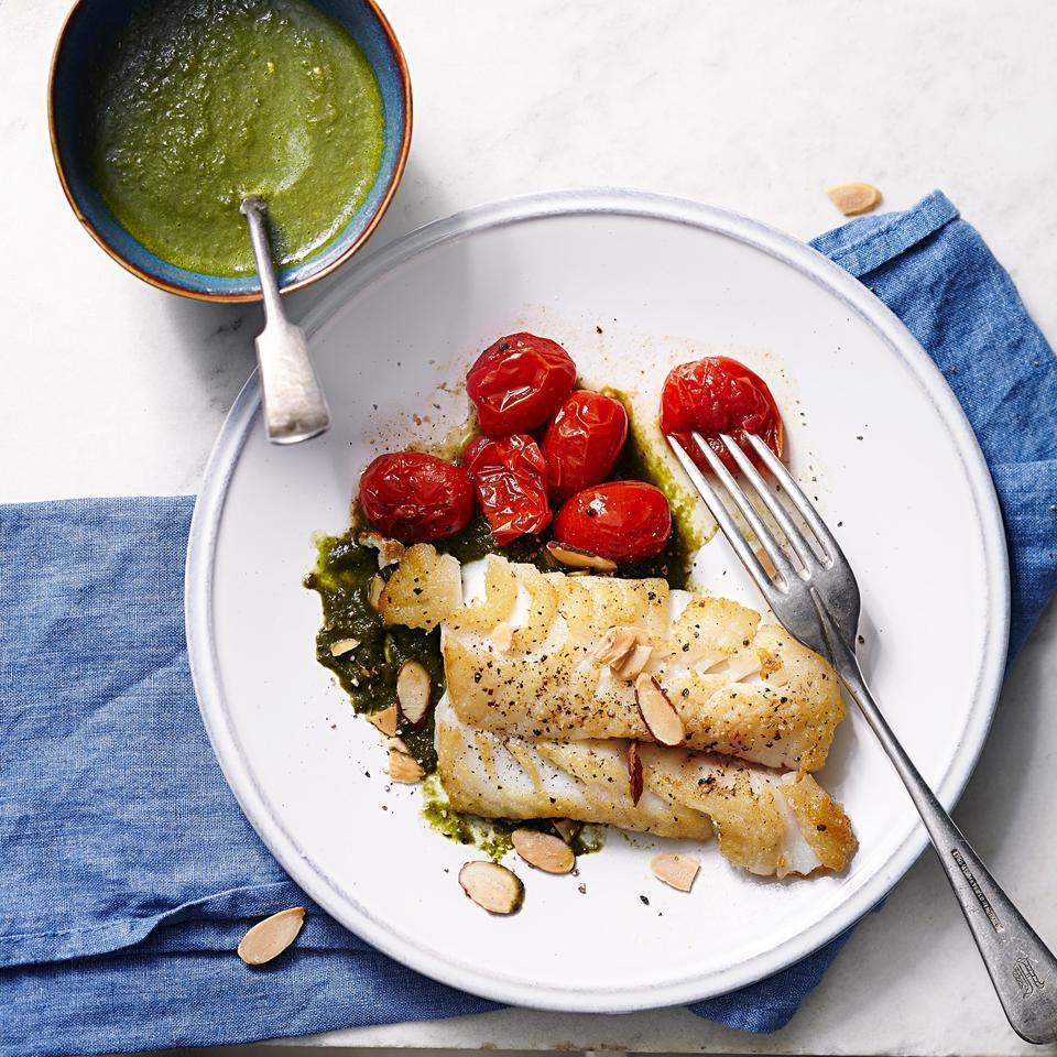 <p>A citrus-laced spinach sauce zests up delicate cod in this healthy fish recipe. If you can find Meyer lemons, use their sweeter juice instead of the regular lemon and orange juices. Serve with roasted cherry tomatoes and zucchini with angel hair pasta.</p>
