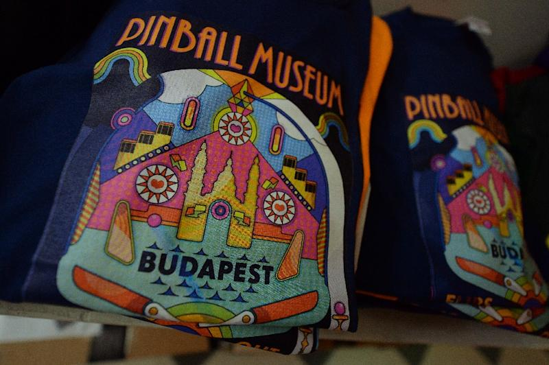 Glistening signs, flashing lights and non-stop tinkling lure scores of tourists in Budapest to Europe's largest pinball museum, where a passionate collector is bent on reviving the once-popular pastime (AFP Photo/Attila Kisbenedek)