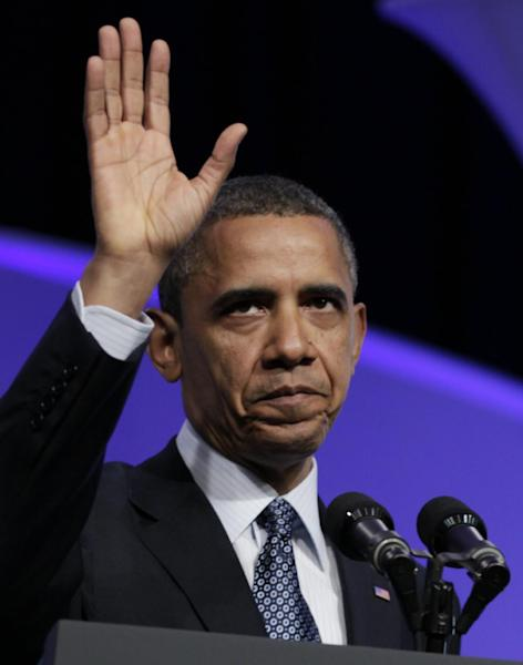 President Barack Obama waves as he leaves The Associated Press luncheon during the ASNE Convention, Tuesday, April 3, 2012, in Washington. (AP Photo/Carolyn Kaster)