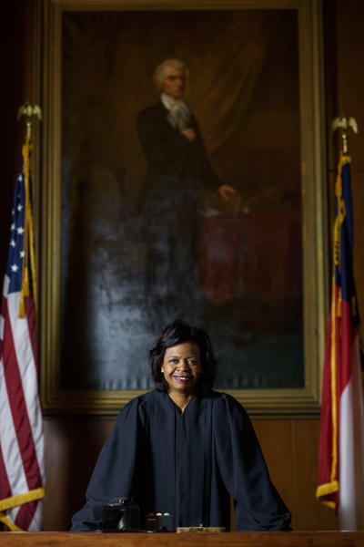 """FILE - In this Feb. 13, 2019, file photo, Cheri Beasley poses for a portrait in the court room from the Chief Justice's seat in Fayetteville, N.C. North Carolina's highest court heard arguments Monday, Aug. 26, on the repealed Racial Justice Act, which allowed condemned inmates to seek a life sentence by using statistics to show that race tainted their trials. During the hearing, Chief Justice Beasley said it seemed an attorney was addressing issues greater than what the cases involved and that he was """"possibly asking this court to address something greater."""" (Melissa Sue Gerrits/The Fayetteville Observer via AP, File)"""