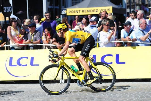 Bradley Wiggins, in the yellow jersey and riding a yellow bike