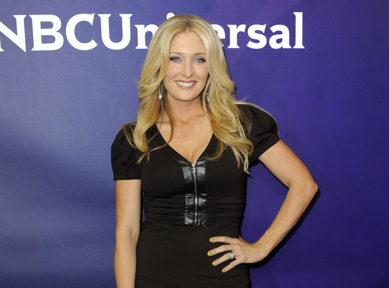 """FILE - In this July 24, 2012 file photo, matchmaker Amber Kelleher-Andrews, from the TV series """"Ready For Love,""""  and chief executive of matchmaking service Kelleher-Andrews attends NBCUniversal's 2012 Summer Press Tour in Beverly Hills, Calif. Darlene Daggett, former president for U.S. commerce for the West Chester-based home shopping channel QVC, settled a lawsuit against Kelleher International for a matchmaking service that set her up with a string of highly incompatible suitors, including men who were married, mentally unstable or felons. (Photo by Jordan Strauss/Invision/AP, File)"""