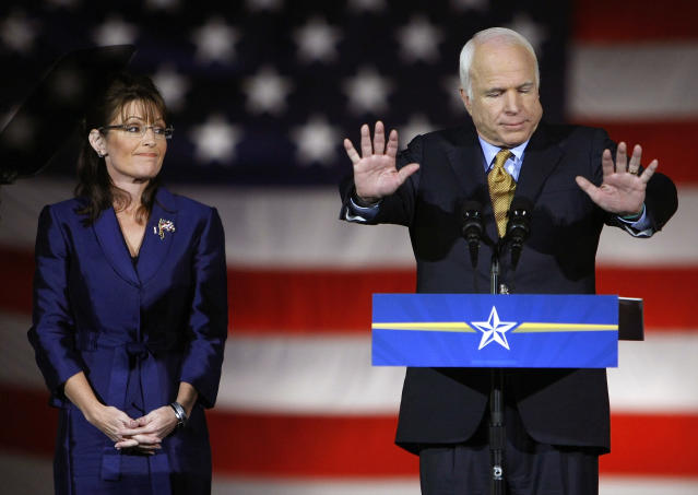 <p>Republican presidential nominee Sen. John McCain speaks to the crowd during his election night rally in Phoenix, Ariz., Nov. 4, 2008. Joining McCain is Republican vice presidential nominee Alaska Gov. Sarah Palin. (Photo: Mike Blake/Reuters) </p>