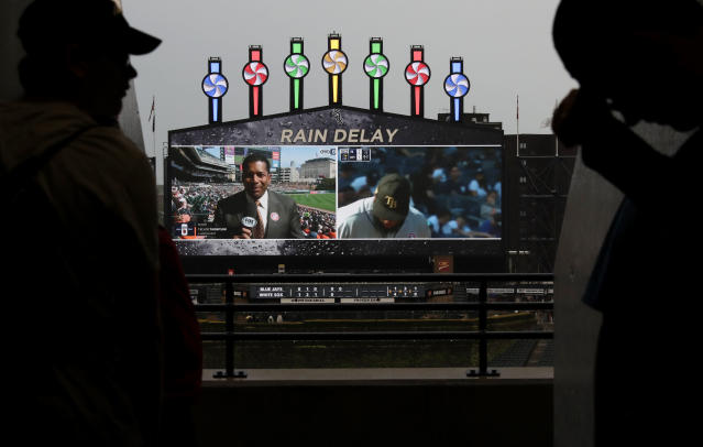 Baseball fans wait out a rain delay during the fifth inning of a baseball game between the Toronto Blue Jays and the Chicago White Sox, in Chicago, Saturday, May 18, 2019. (AP Photo/Nam Y. Huh)