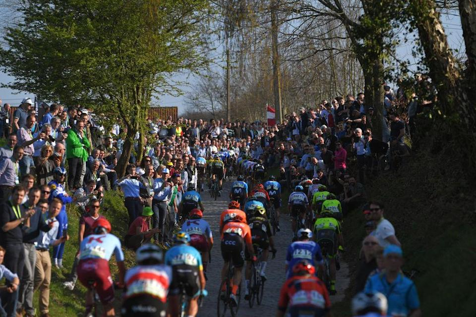Fans line the side of the road on the climb of the Oude Kwaremont during the 2019 edition of the E3 BinckBank Classic, which was cancelled in 2020 due to the coronavirus pandemic