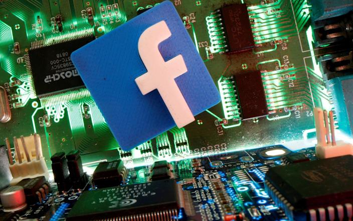 Facebook symbol on a motherboard - Reuters
