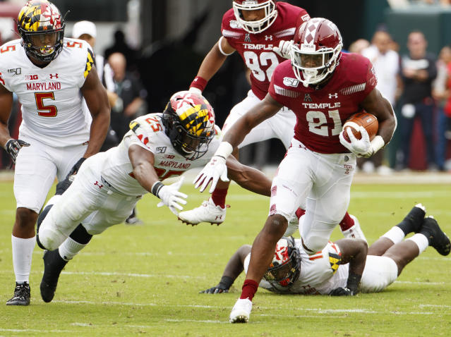 Temple running back Jager Gardner (21) carries with the ball as he tries to get past Maryland defensive back Antoine Brooks Jr. (25) during the first half of an NCAA college football, Saturday, Sept. 14, 2019, in Philadelphia. (AP Photo/Chris Szagola)