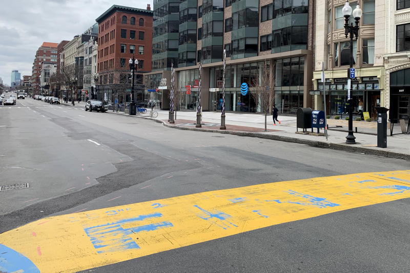 The Boston Marathon finish line is shown on Boylston Street, shown virtually deserted on April 08, 2020 in Boston, Massachusetts. The Boston Marathon has been postponed to September 14 due to the coronavirus pandemic. A stay-at-home order by by Gov. Charlie Baker is in effect through May 4, while Boston Mayor Marty Walsh has enacted a recommended curfew of 9 p.m. and is encouraging the use of face masks in public spaces. (Photo by Maddie Meyer/Getty Images)