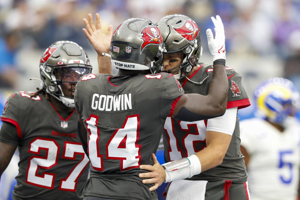 INGLEWOOD, CA - SEPTEMBER 26: Tampa Bay Buccaneers wide receiver Chris Godwin (14) celebrates with Tampa Bay Buccaneers quarterback Tom Brady (12) after a touchdown during a game between the Tampa Bay Buccaneers and the Los Angeles Rams at SoFi Stadium on September 26, 2021 in Inglewood, California. (Photo by Jordon Kelly/Icon Sportswire via Getty Images)