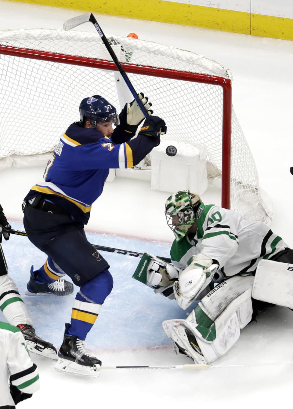 St. Louis Blues' Pat Maroon, left, celebrates after scoring against Dallas Stars goaltender Ben Bishop during the second overtime in Game 7 of an NHL second-round hockey playoff series Tuesday, May 7, 2019, in St. Louis. The Blues won 2-1 to take the series. (AP Photo/Jeff Roberson)