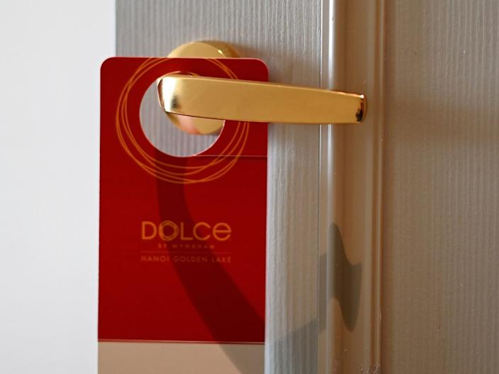 A placard hangs on a room's doorknob at the Dolce Hanoi Golden Lake hotel in Hanoi, Vietnam on July 2, 2020.