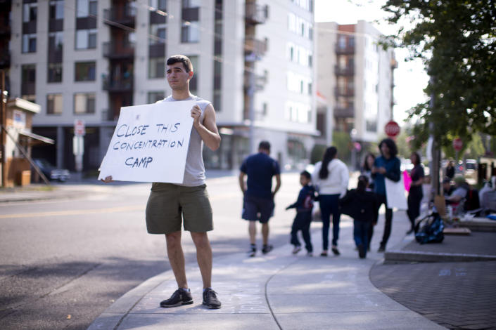 <p>A round-the-clock vigil is underway ICE headquarters in Portland, Ore. About two dozen protesters gathered June 19, 2018, for a round-the-clock vigil and vowed not to leave until the policy was changed. (Photo: Beth Nakamura/The Oregonian via AP) </p>