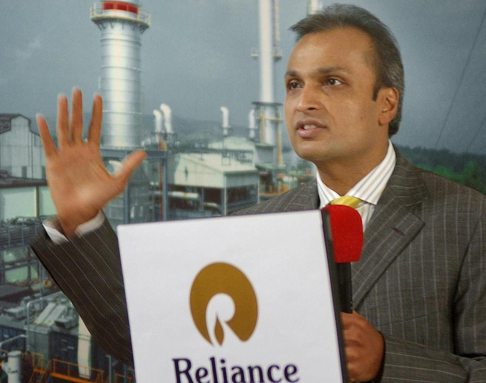 India's largest private sector group Reliance Industries Ltd Vice Chairman and Managing Director Anil Ambani gestures as he announces the company's results of the year in Bombay, 29 April 2004. India's biggest petrochemicals producer, Reliance Industries, posted a 26 percent rise in full year net profit to 51.60 billion rupees (1.16 billion dollars), helped by surging fuel and chemical prices. AFP PHOTO/Sebastian D'SOUZA.