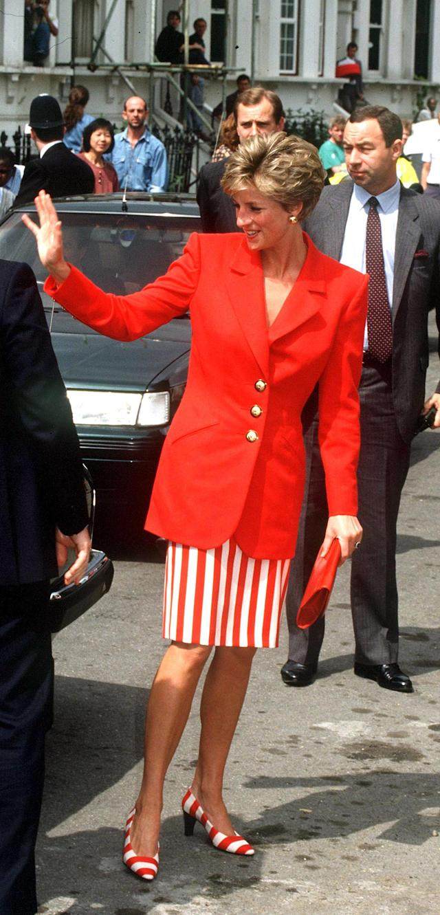 <p>In later years, the Princess of Wales wore her stripes a bit more toned-down — or so you'd think until getting a look at her matching shoes. Cheeky!(Photo: Jayne Fincher/Princess Diana Archive/Getty Images) </p>