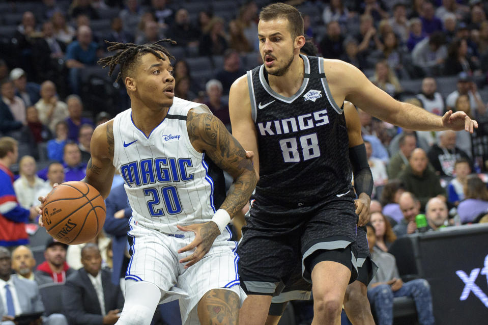Orlando Magic guard Markelle Fultz (20) is defended by Sacramento Kings forward Nemanja Bjelica (88) during the first quarter of an NBA basketball game in Sacramento, Calif., Monday, Jan. 13, 2020. (AP Photo/Randall Benton)