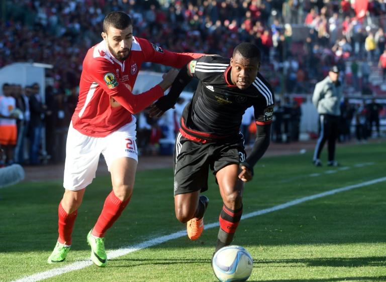 South Africa's Orlando Pirate's Aubrey Gabuza (R) fights for the ball with Etoile du Sahel's Haythem Ben Salem during the second final of the 2015 CAF Confederation Cup match, in Sousse, Tunisia, on November 29, 2015