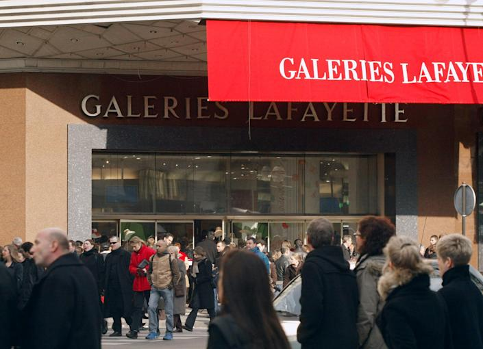Shops on the Boulevard Huassmann in Paris would be able to open every Sunday under a proposed new law (AFP Photo/Philippe Desmazes)