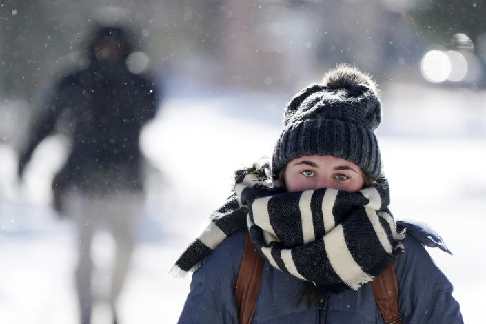 Jillian Hansen, a senior at the University of Minnesota studying political science, walks on campus wrapped up in an oversized scarf as snow flurries floated in the air, Jan. 29, 2019, in Minneapolis. (Photo: Anthony Souffle/Star Tribune via AP)