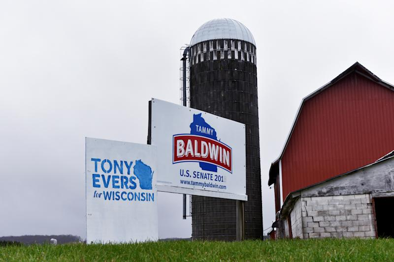 Signs for Tony Evers and Tammy Baldwin