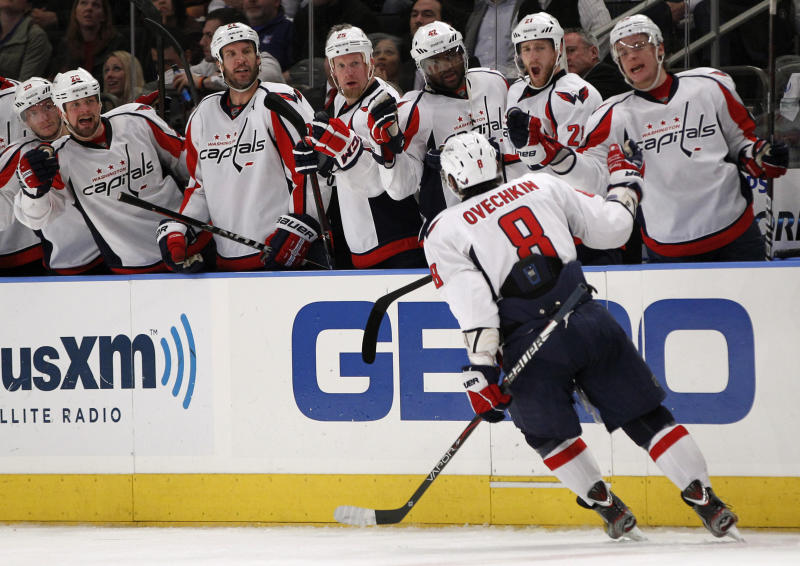 Teammates greet Washington Capitals Alex Ovechkin (8) after he scored the winning goal in the third period of Game 2 of the NHL Eastern Conference semifinals at Madison Square Garden in New York, Monday, April 30, 2012. The Capitals defeated the Rangers 3-2. (AP Photo/Kathy Willens)