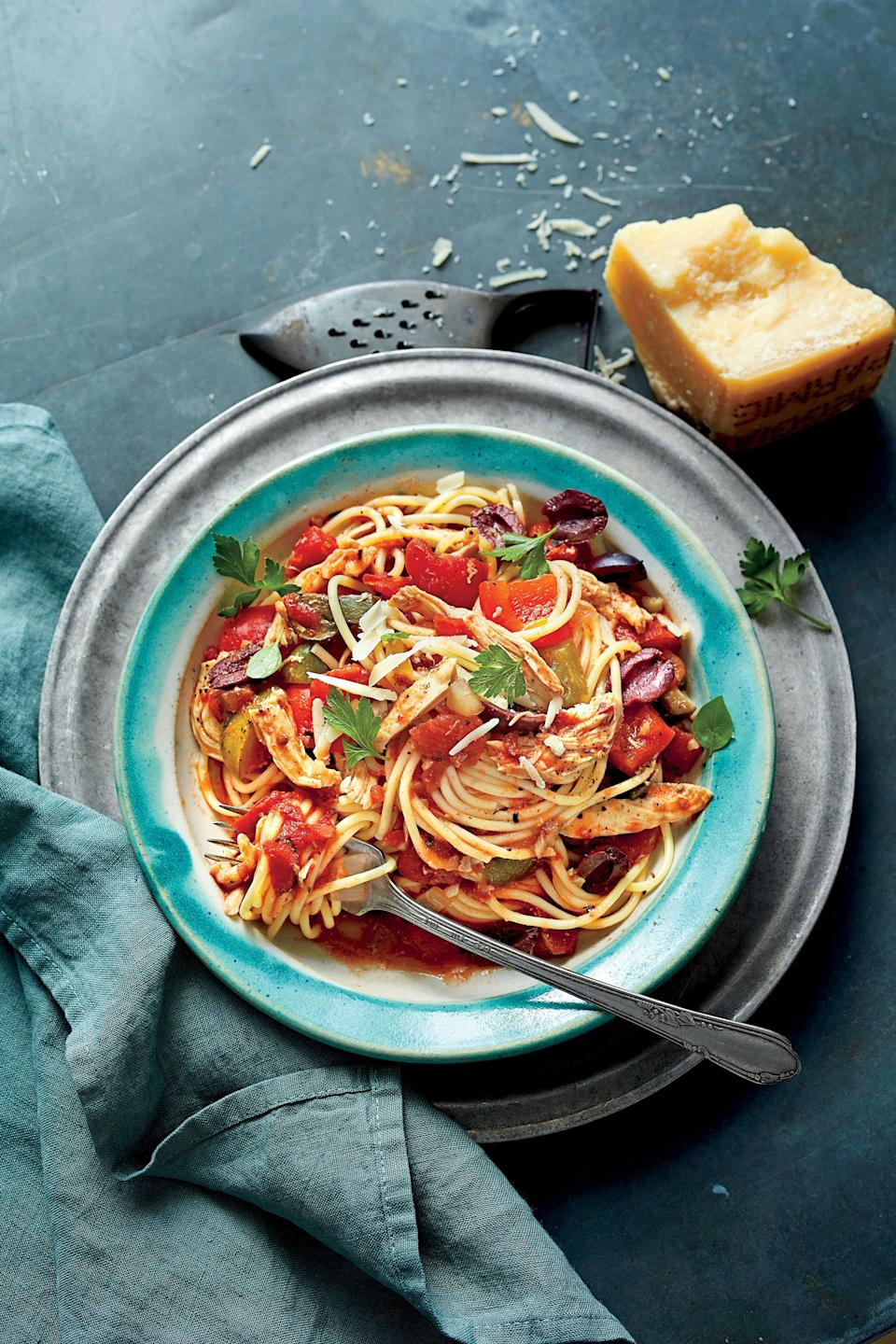 """<p><strong>Recipe: <a href=""""https://www.southernliving.com/syndication/slow-cooker-chicken-cacciatore-spaghetti"""" rel=""""nofollow noopener"""" target=""""_blank"""" data-ylk=""""slk:Slow-Cooker Chicken Cacciatore with Spaghetti"""" class=""""link rapid-noclick-resp"""">Slow-Cooker Chicken Cacciatore with Spaghetti</a></strong></p> <p>Spend 20 minutes in the kitchen prepping this gorgeous, hearty sauce. Once the sauce simmers in the cooker, all that's left to do is cook a pound of pasta, and serve.</p>"""