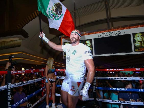 Tyson Fury adopted the colours of Mexico during his open workout (PA)