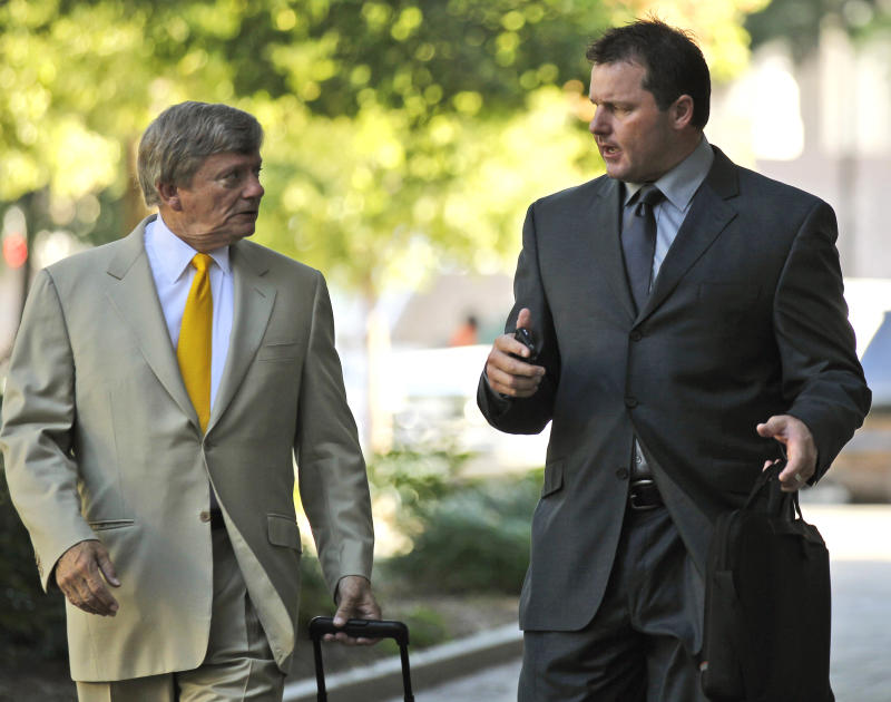 Former Major League Baseball pitcher Roger Clemens, right, and his attorney Rusty Hardin, arrive at federal court in Washington, Wednesday, July 13, 2011, for his perjury trial. The newly seated jury of 10 women and two men is scheduled to get to work Wednesday with opening arguments.  (AP Photo/Alex Brandon)