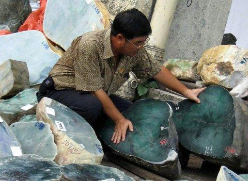 A foreign buyer checks the quality of stones in Myanmar