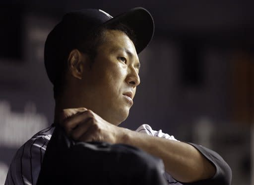 New York Yankees starting pitcher Hiroki Kuroda, of Japan, puts on his jacket after leaving the baseball game against the Minnesota Twins during the fifth inning at Yankee Stadium in New York, Wednesday, April 18, 2012. (AP Photo/Frank Franklin II)
