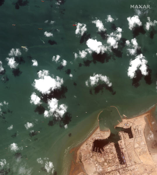 This Monday, July 22, 2019 Maxar Technologies shows an overview of Iranian port city of Bandar Abbas with the British-flagged oil tanker Stena Impero at the top center. President Hassan Rouhani suggested on Wednesday, July 24,  that Iran might release the U.K.-flagged ship if Britain takes similar steps to release an Iranian oil tanker seized by the British Royal Navy off Gibraltar earlier this month. His remarks could create an opening to reduce tensions as Boris Johnson becomes prime minister.   (Satellite image ©2019 Maxar Technologies via AP)