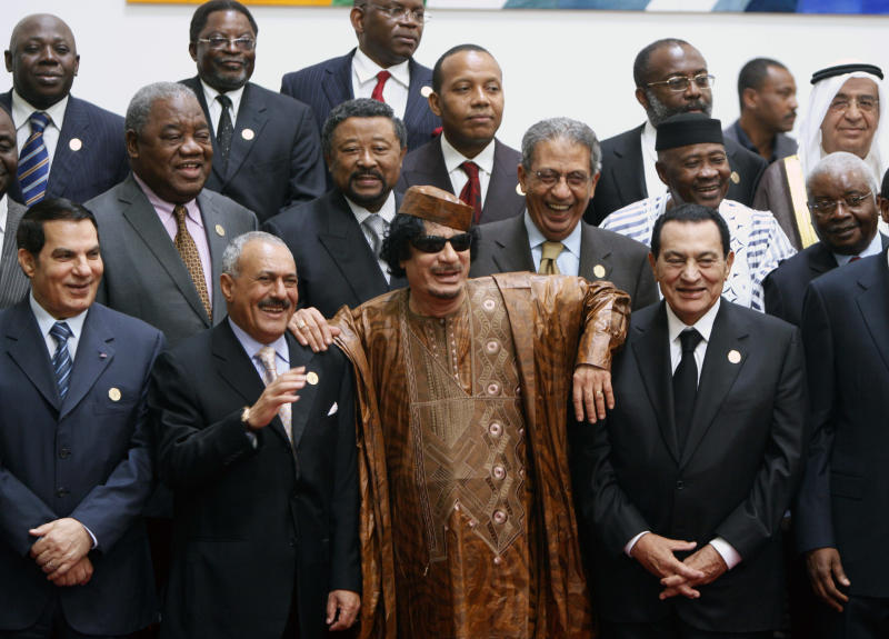 FILE - In this Oct. 10, 2010 file photo, Libyan leader Moammar Gadhafi, center, with Egyptian President Hosni Mubarak, right, and his Yemeni counterpart Ali Abdullah Saleh, center left, pose for a group photo with Arab and African leaders during the second Afro-Arab summit in Sirte, Libya,  (AP Photo/Amr Nabil)