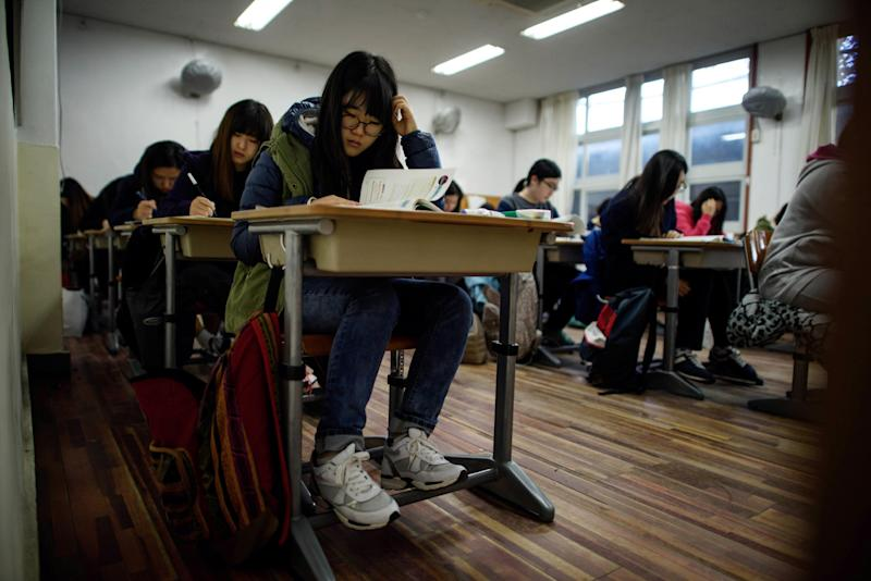Students sit the Scolastic Aptitude Test at Poongmun high school in Seoul, November 13, 2014. The college entrance exam will play a large part in defining their adult lives (AFP Photo/Ed Jones)