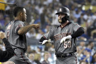 Arizona Diamondbacks' Christian Walker (53) is congratulated by Ketel Marte after hitting a solo home run in the sixth inning of a baseball game against the Los Angeles Dodgers, Saturday, Sept. 1, 2018, in Los Angeles. (AP Photo/Michael Owen Baker)