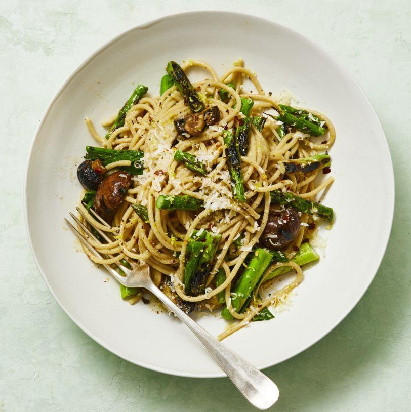 """<p>Boost your immunity with this pasta dish, thanks to the antioxidants in the mushrooms and the vitamin C in the asparagus. Grilling the veggies gives the dish a little bit of a smoky char that perfectly complements the nutty pasta. <br></p><p><em><a href=""""https://www.womansday.com/food-recipes/a32699458/whole-wheat-spaghetti-with-grilled-asparagus-and-scallions-recipe/"""" rel=""""nofollow noopener"""" target=""""_blank"""" data-ylk=""""slk:Get the Whole-Wheat Spaghetti with Grilled Asparagus and Scallions recipe."""" class=""""link rapid-noclick-resp"""">Get the Whole-Wheat Spaghetti with Grilled Asparagus and Scallions recipe.</a></em></p>"""