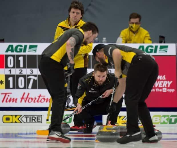 Team Mike McEwen earned an opening win on Wednesday in Ottawa at the Canadian Curling Trials.  (Curling Canada/Twitter - image credit)