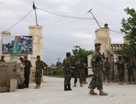 Afghan national Army (ANA) troops keep watch near the site of an ongoing attack on an army headquarters in Mazar-i-Sharif