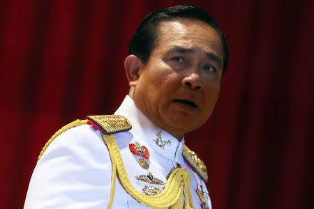 Thai Army chief General Prayuth Chan-ocha looks at reporters after addressing them at the Royal Thai Army Headquarters in Bangkok