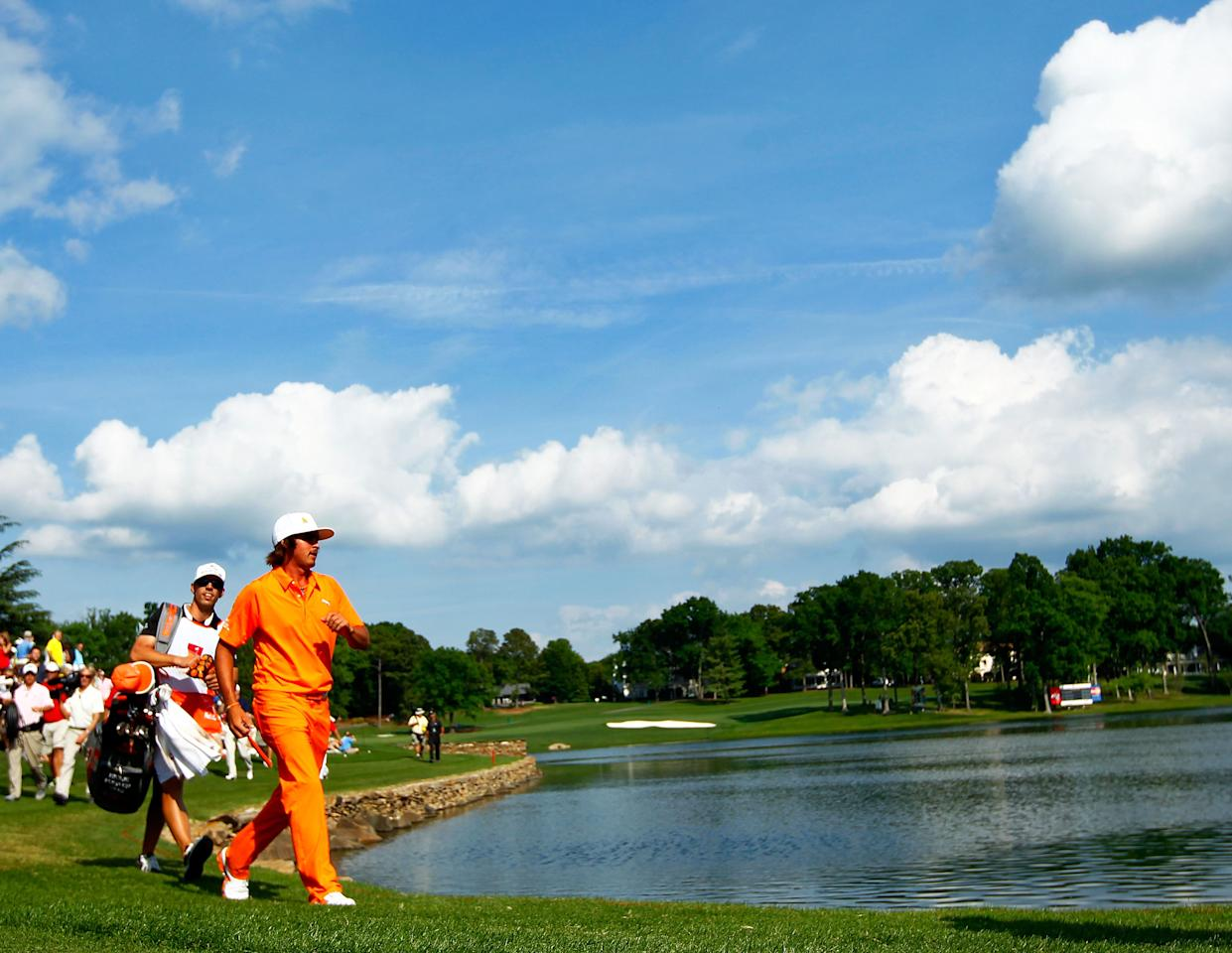 CHARLOTTE, NC - MAY 06: Rickie Fowler (R) of the United States and caddie Joseph Skovron (L) walk to the 17th green during the final round of the Wells Fargo Championship at the Quail Hollow Club on May 6, 2012 in Charlotte, North Carolina.  (Photo by Mike Ehrmann/Getty Images)
