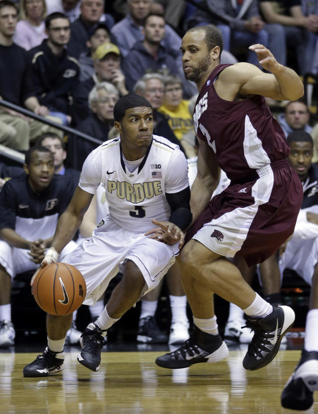 Purdue guard Ronnie Johnson, left, drives on Maryland-Eastern Shore guard Ishaq Pitt during the second half of an NCAA college basketball game in West Lafayette, Ind., Tuesday, Dec. 17, 2013. Purdue defeated Maryland-Eastern Shore 79-50. (AP Photo/Michael Conroy)